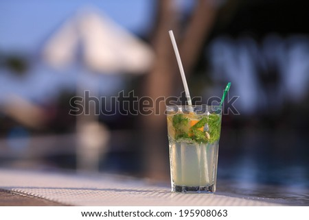 Mojito Drink standing at the edge of the swimming pool