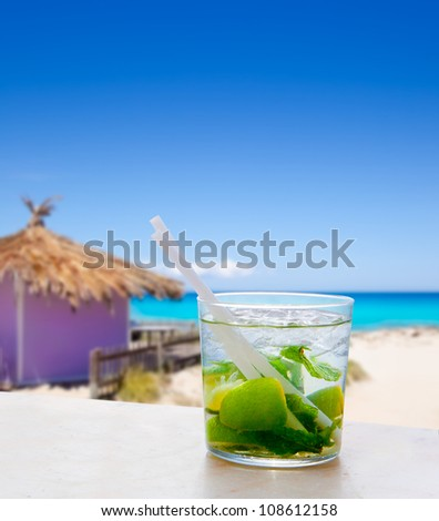 Mojito in Formentera tropical purple hut on turquoise white sand beach [ photo-illustration]