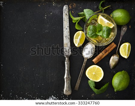 Mojito ingredients on black rustic background - stock photo