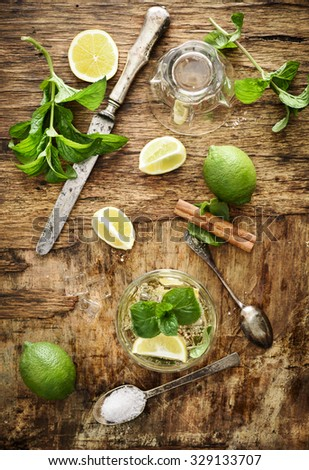 Mojito ingredients on rustic wooden background