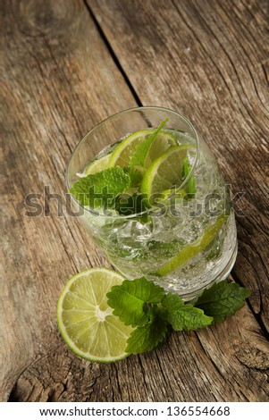 mojito lime cocktails on the wooden background - stock photo