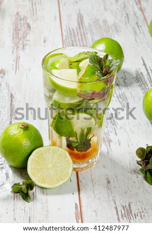 Mojito lime drink on wood with blur beach background