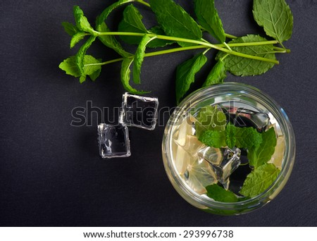 Mojito lime drinks on stone, shot from upper view - stock photo