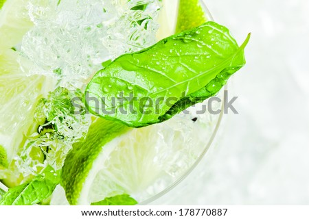 Mojito , lime pieces , leaves of mint with ice and rum