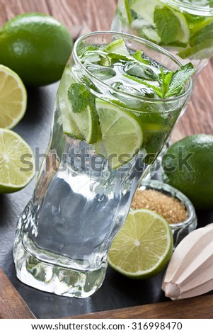 Mojitos cocktail refreshing summer drink on rustic wooden table - stock photo