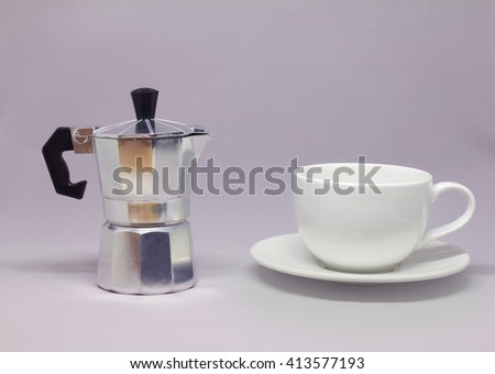 Moka pot and coffee cup background