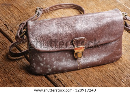 mold on old brown leather bag - stock photo