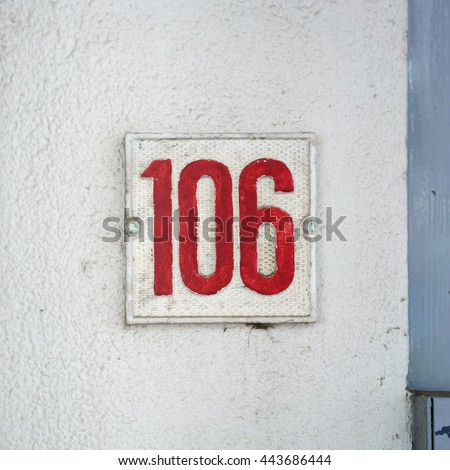 Molded house number one hundred and six. - stock photo