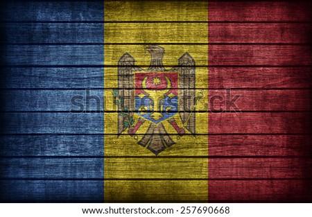Moldova flag pattern on wooden board texture ,retro vintage style - stock photo