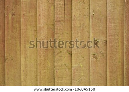 moldy brown decks of old wooden fence - stock photo