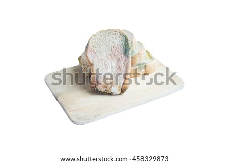 Moldy Whole wheat bread loaf on cutting board over white background