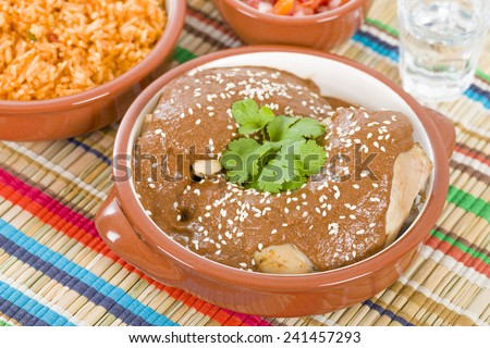 Mole Poblano - Chicken with mole sauce and side dishes. Traditional Mexican food.