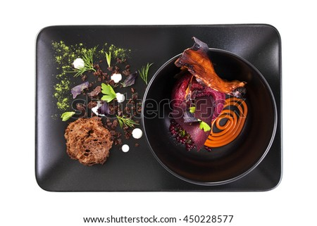 Molecular Cuisine. Delicious modern soup with beetroot. Isolated on white. Stock image.