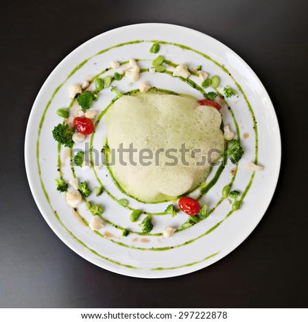 molecular cuisine fish in a dish with beautiful garnish in plan - stock photo