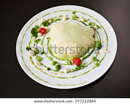 molecular cuisine fish in a dish with beautiful garnish with perspective - stock photo
