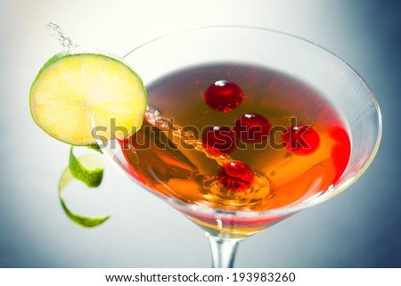 Molecular mixology - whisky acocktail and raspberry sphere - stock photo