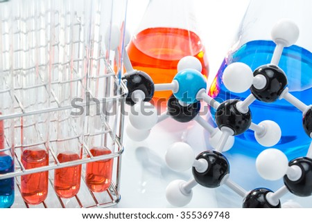 Molecular Structure and colorful liquid on white background - stock photo
