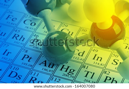 Molecule model on periodic table of the elements - stock photo