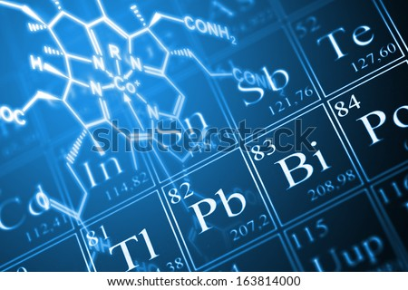 Molecule structural formula model on periodic table of the elements - stock photo