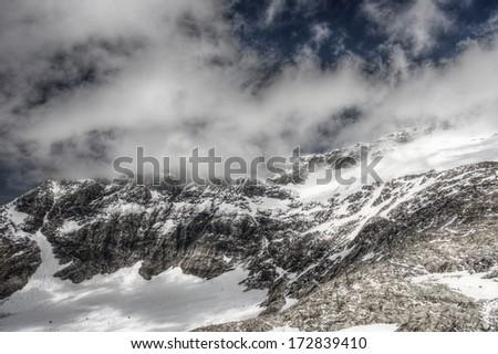 Molltaller Glacier Mountains under cloudy sky - stock photo
