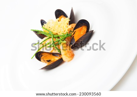 Mollusk and mussels appetizer prepared at a restaurant, isolated on white, vertical format - stock photo