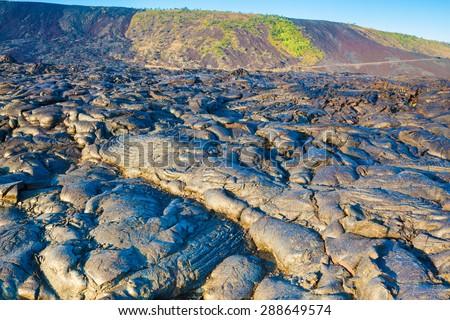 Molten cooled lava landscape in Hawaii Volcanoes National Park, Big Island, Hawaii - stock photo