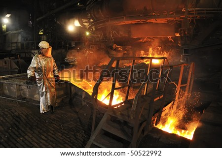 Molten hot steel pouring and worker