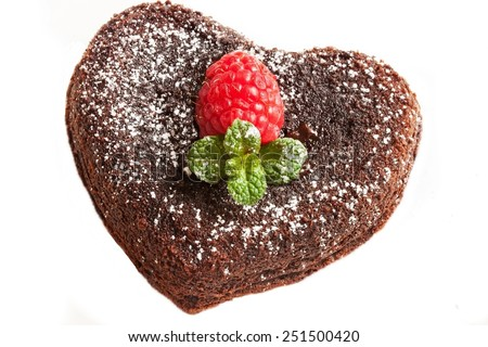 Molten lava cake in heart shape isolated on white - stock photo