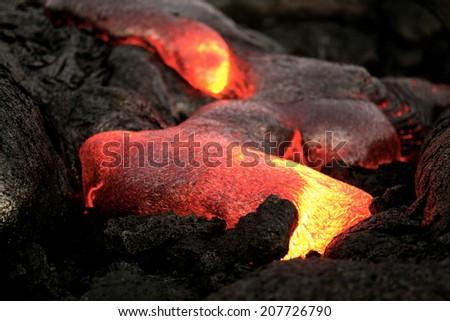Molten lava during active eruption - stock photo