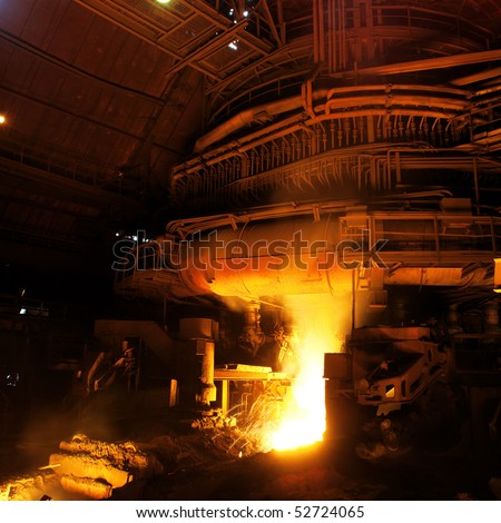 Molten liquid iron is poured. Iron casting.