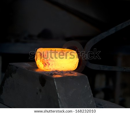 Molten metal in the smithy on the anvil