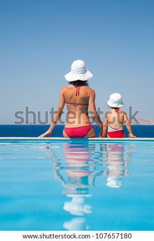Mom and Baby at the Pool - stock photo