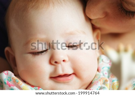 Mom and baby faces closeup - stock photo