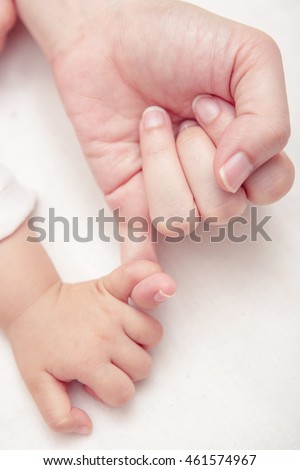 Mom and Baby Hands Promise. friendship of generations, Soft focus and blurry (vintage style color effect)