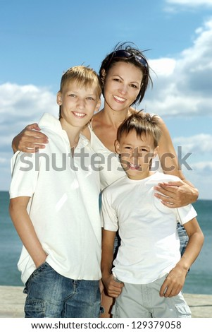 Mom and children on the background of the sea