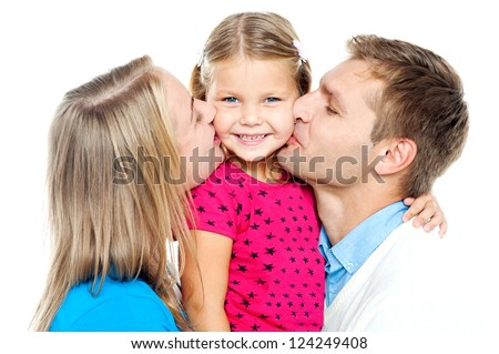 Mom and dad kissing their beautiful kid on cheeks from both the sides - stock photo