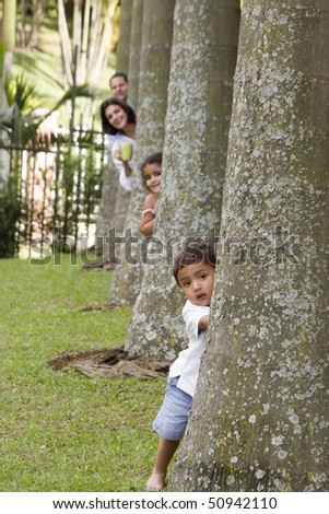 Mom and dad playing with their children - stock photo
