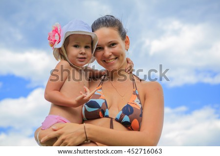 mom and daughter are bathing in river water nature Russia