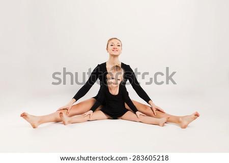 Mom and daughter do gymnastics. family sports  - stock photo