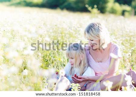 Mom and daughter on nature. Happy family mother and daughter.Mother and daughter walking in the park