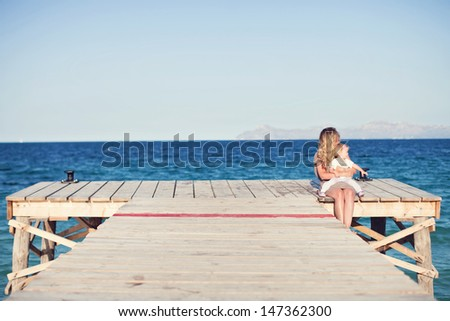 mom and daughter on the pier