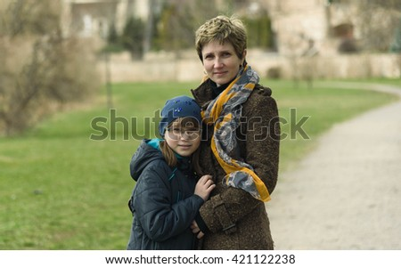 mom and daughter standing on the track in spring Park - stock photo