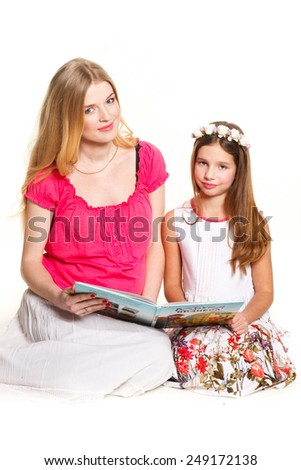 Mom and daughter teach lessons on a white background - stock photo