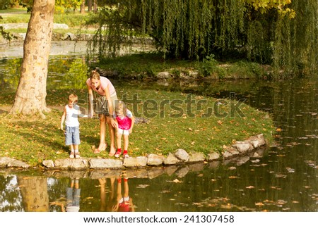 Mom and her kids in the park - stock photo