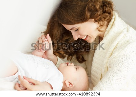 Mom and her newborn baby. Mother's day - stock photo