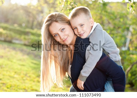 Mom and her son enjoyed the walk - stock photo