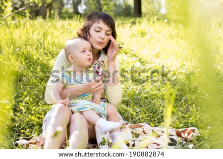 mom and kid outdoors at summer - stock photo