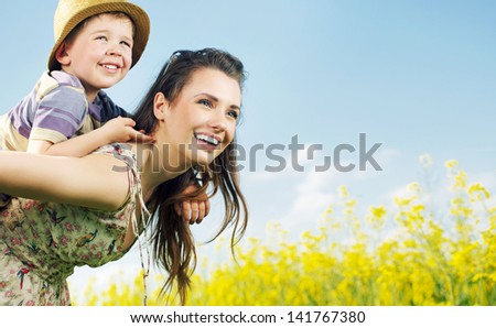 Mom and son having fun - stock photo