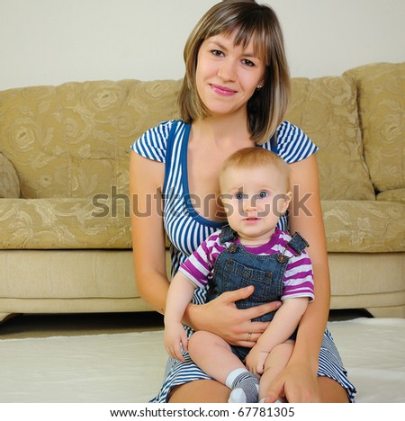 Mom and son having fun together. symbol of family - stock photo