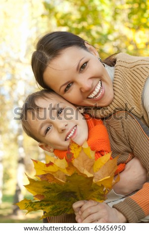 Mom and son walking in a park - stock photo